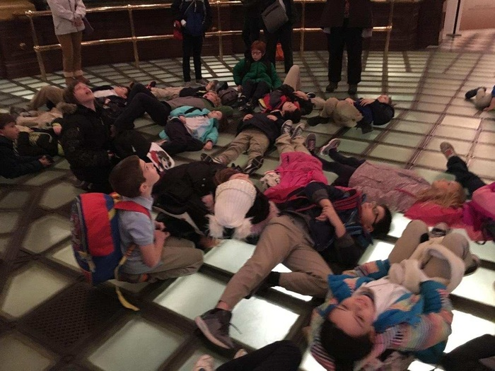 Third and fourth grades on the floor under the dome.