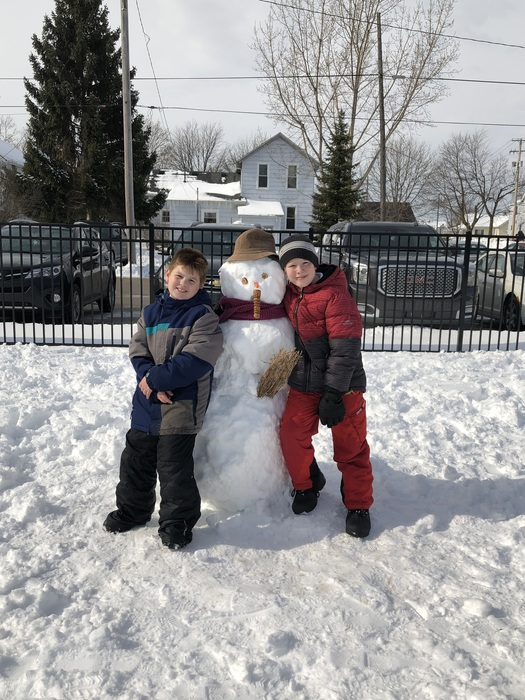 Proud of their snowman